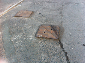 Drumbeg Mews - raised manhole covers