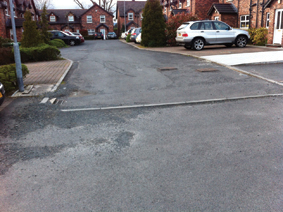 Drumbeg Mews - wide shot of uneven road surface